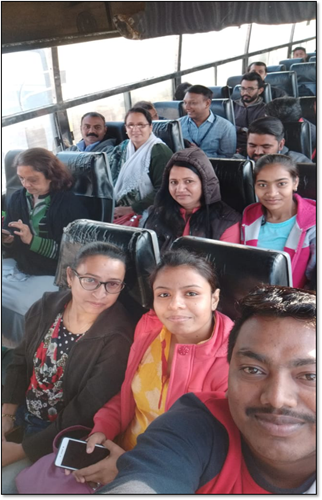 Participant  employees from various locations enjoying the bus ride to Paladi for the games and fun